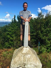 Kenny Hancock at the symbolic end point of The Long Trail at the border of Canada and Vermont.