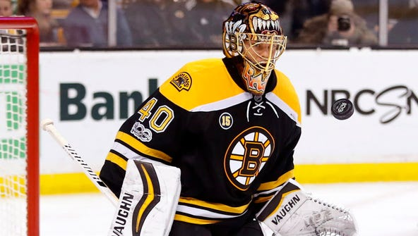 Boston Bruins goalie Tuukka Rask makes a save against