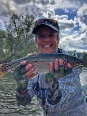 Starr Nolan holds a prize rainbow trout. Nolan, of