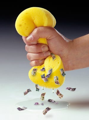 Photo of a hand squeezing a sponge, composited with images of water droplets and banknotes which have been digitally manipulated to appear to be squeezing out of the sponge.