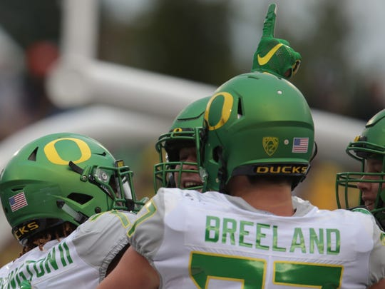 Nov 26, 2016; Corvallis, OR, USA; Oregon Ducks wide receiver Darren Carrington II (7) holds his hand in the air following a touchdown and celebrates with tight end Jacob Breeland (27) against the Oregon State Beavers at Reser Stadium. Mandatory Credit: Scott Olmos-USA TODAY Sports