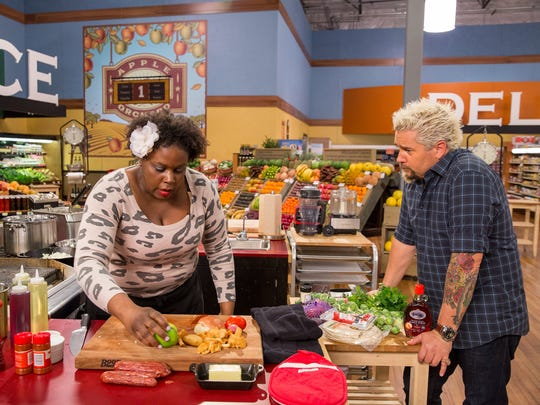 "Chef Reva Constantine is with Guy Fieri as she competes on ""Guy's Grocery Games"" show on the Food Network."
