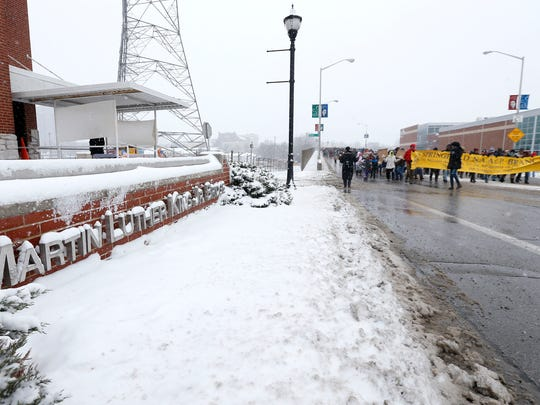 Snow and freezing temperatures didn't keep several hundred people from marching as part of the annual Martin Luther King Jr. March and Celebration in downtown Springfield on Jan. 15, 2018. The forecast for Monday is cold but sunny.