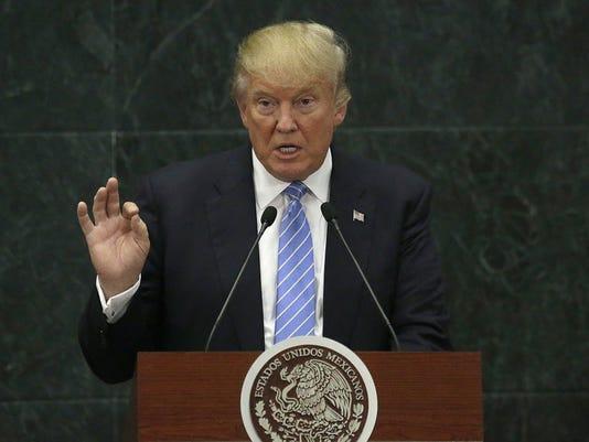 636283774186005002-trump-and-immigrationBX216-380E-9.JPG
