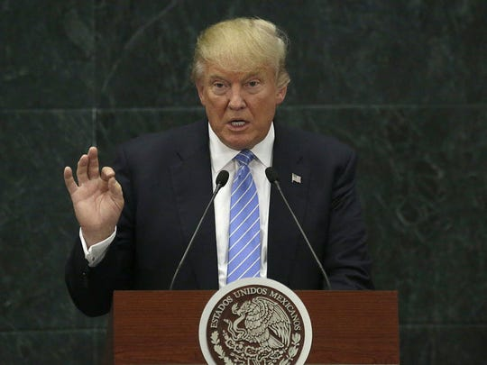 In this Aug. 31, 2016 file photo, Republican presidential nominee Donald Trump speaks during a joint statement with Mexico's President Enrique Pena Nieto in Mexico City.