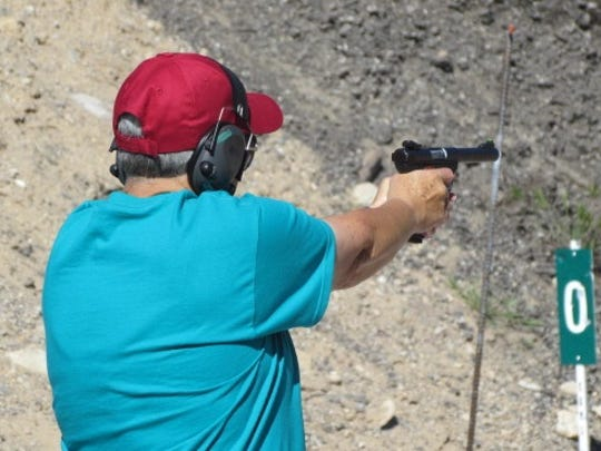 Vicki Jenks competes in the pistol shooting event at the Mesquite Senior Games.