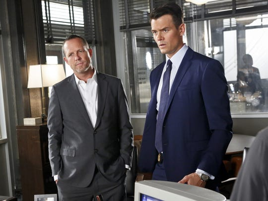 Dean Winters portrays Det. Russ Agnew, left, and Josh