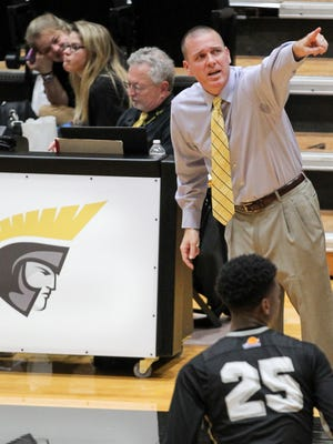 Anderson University head coach Jeff Brookman stands near the new scorer's table at Abney Center.