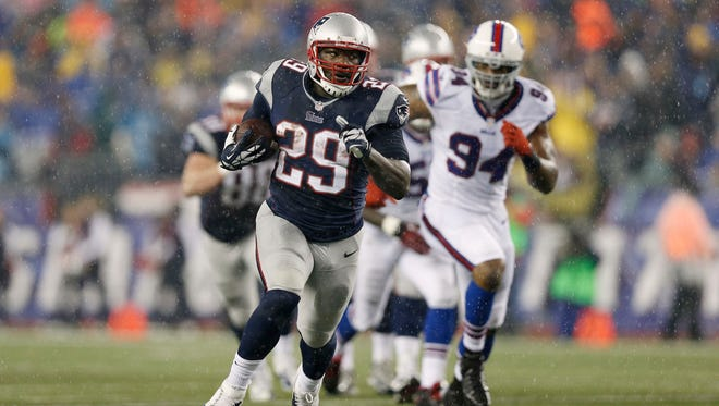New England Patriots running back LeGarrette Blount (29) runs for a touchdown past Buffalo Bills defensive end Mario Williams (94) during the second quarter at Gillette Stadium.