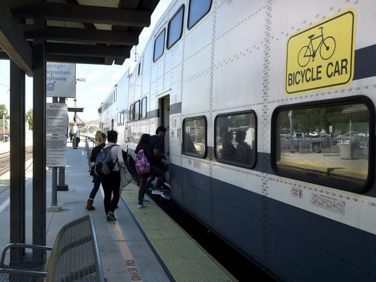Passengers board a Metrolink commuter train at the Moorpark station on Wednesday. A proposed half-cent transportation sales tax measure, known as Measure AA, will be on the ballot countywide Nov. 8.