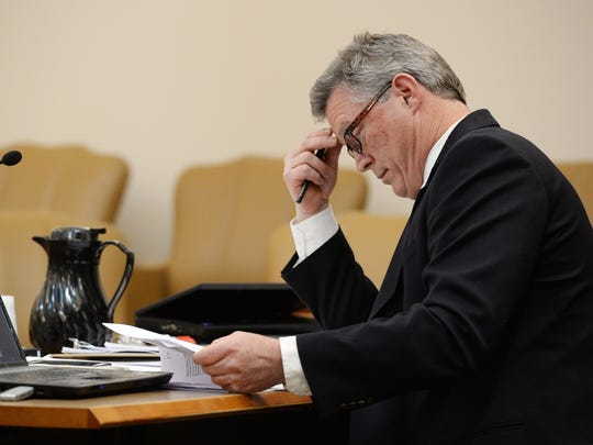 Eric Sutherland looks over documents in Judge Thomas French's courtroom at Larimer County Justice Center on Tuesday, January 10, 2016. Sutherland and PSD went to court for a trial over whether or not Sutherland was denied due process when his pre-election lawsuit was thrown out when he failed to pay a requested $8,000 surety bond.