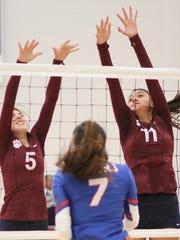Kari Dominguez (5) and Vanessa Garcia (11) team on