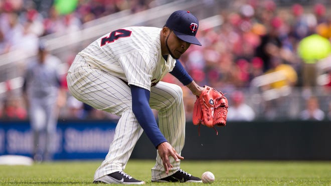 Minnesota Twins starting pitcher Ervin Santana (54) fields a ground ball in the first inning Saturday against the Tampa Bay Rays at Target Field in Minneapolis.
