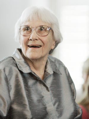 Harper Lee smiles during a ceremony honoring the four new members of the Alabama Academy of Honor at the Capitol in Montgomery, Ala.