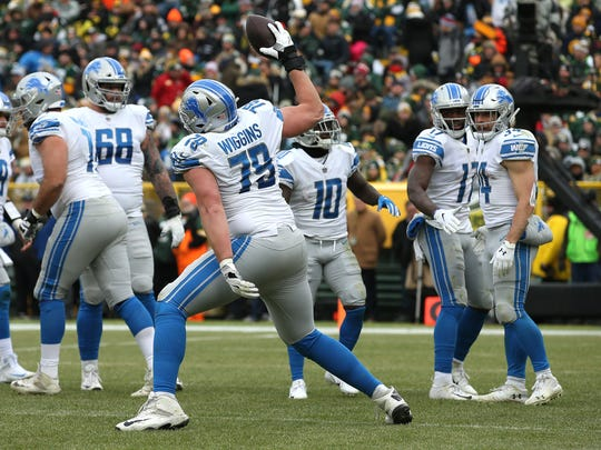 GREEN BAY, WISCONSIN - DECEMBER 30: Kenny Wiggins #79 of the Detroit Lions spikes the ball in celebration after a touchdown run by Zach Zenner #34 during the first half of a game against the Green Bay Packers at Lambeau Field on December 30, 2018 in Green Bay, Wisconsin. (Photo by Dylan Buell/Getty Images)