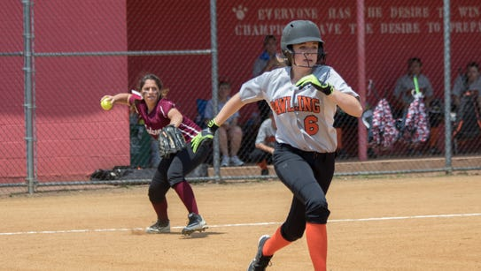 Sarah Campbell of Pawling HS attempts to reach first