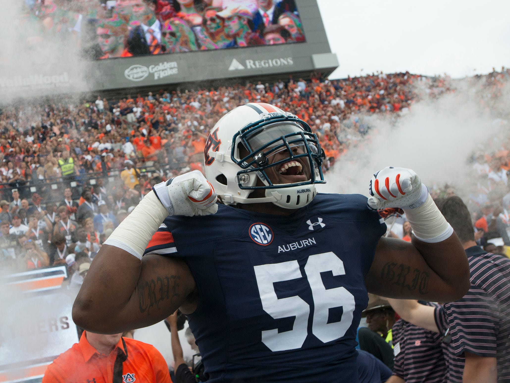Auburn Tigers offensive lineman Avery Young (56) flexes during pre game of the NCAA Auburn vs. Jacksonville State on Saturday, Sept. 12, 2015, in at Jordan-Hare Stadium in Auburn, Ala. (AP Photo/Montgomery Advertiser/Albert Cesare) Albert Cesare / Advertiser