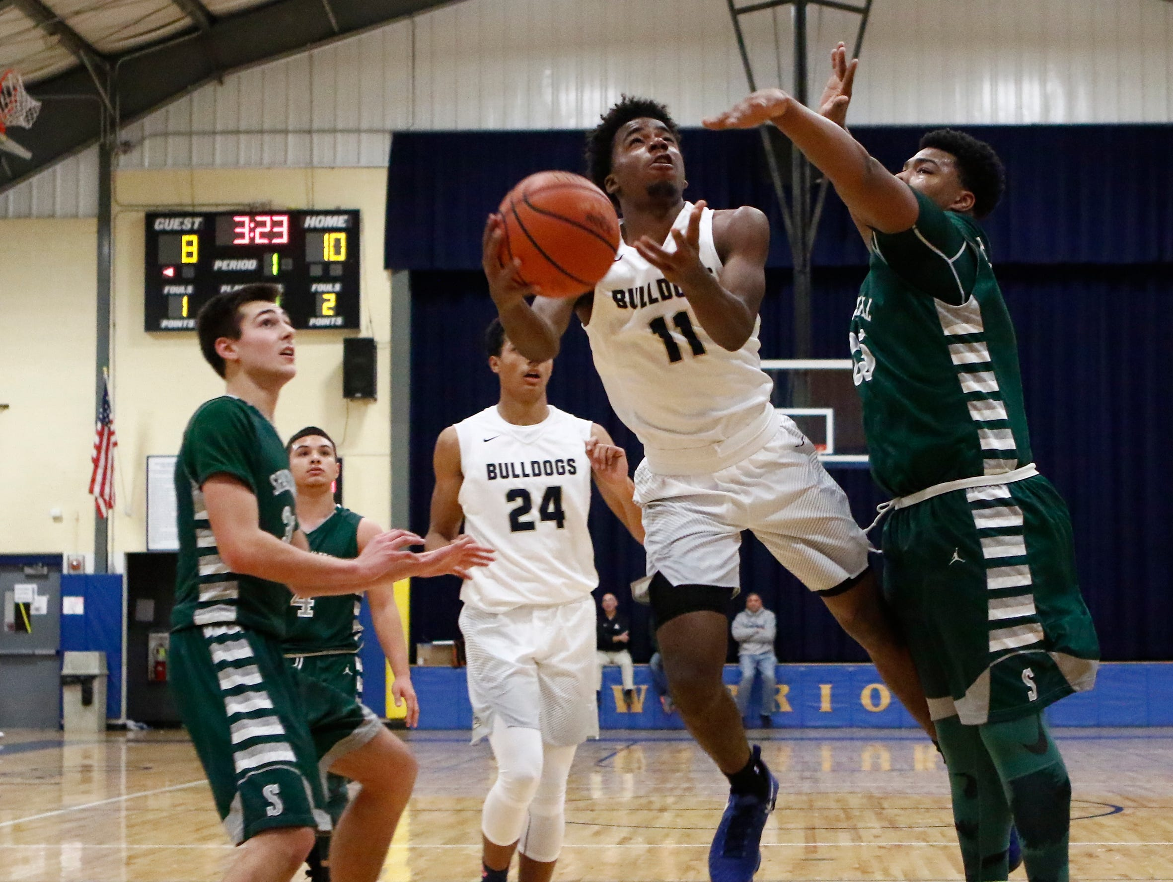 Beacon's Zamere McKenzie (11) drives on Spackenkill's Kyiev Bennermon (25) in the championship game of the Duane Davis memorial basketball tournament at Our Lady of Lourdes High School in Poughkeepsie on Saturday, December 31, 2016.