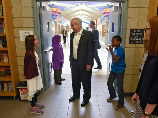 Gov. Mark Dayton speaks with Talahi Community School students after his arrival Thursday, May 10, in St. Cloud during a tour to promote his proposal for emergency school aid.