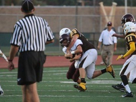 Jordon Machlis makes a crunching tackle on an opponent.