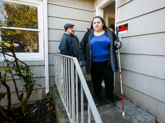 Jason Lindial and his partner Jetzabel Franco lock up as they leave their home on Tuesday, Jan. 24, 2017. The pair were beginning the move-in process last week when their home was burglarized and valuable items were stolen. Franco is legally blind and Lindial is partially blind.