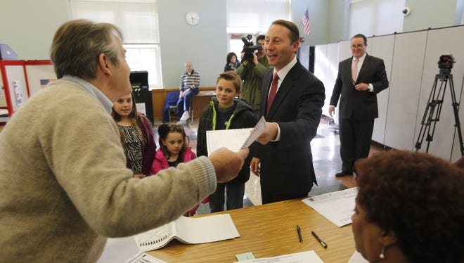 Westchester County Executive Robert Astorino enters with his family to vote at the Hawthorne Elementary School in Hawthorne on Nov. 5, 2013.   ( Ricky Flores / The Journal News )