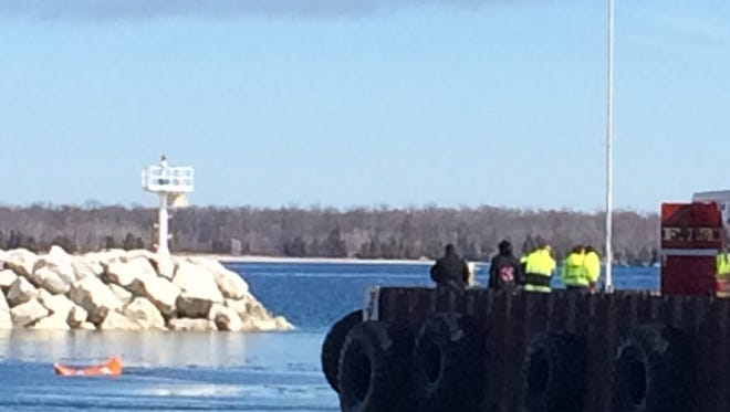 The Door County Dive Team use flotation devices to lift a submerged car out of the water off the Washington Island Ferry Line pier in Northport on Friday.