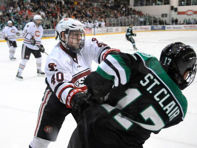 St. Cloud State's Tim Daly and Colten St. Clair of North Dakota get tangled along the boards during the second period of Saturday's game at the Herb Brooks National Hockey Center in St. Cloud.