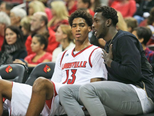 Louisville's Mangok Mathiang talks with freshman Raymond Spalding during the Red-White scrimmage game.