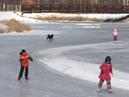 Edward, 9, and Audrey, 7, Zheng skate a lap on the