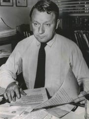 James Reston, head of the Washington Bureau of The New York Times, works at his desk in 1957, after winning the Pulitzer Prize for national reporting. Reston previously won a Pulitzer in 1945.