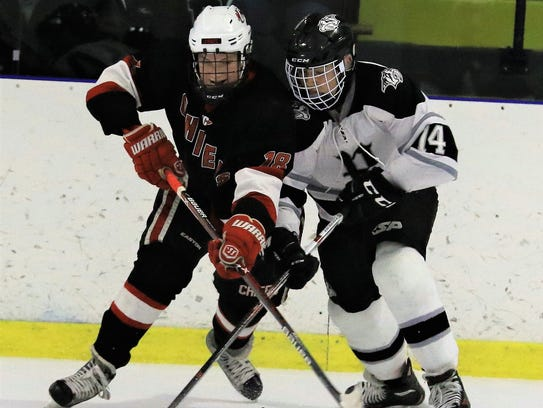 Canton's Emerson Taylor (left) and Plymouth's Luke