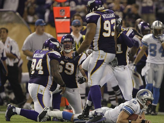 Lions QB Dan Orlovsky is sacked by the Vikings' Jared
