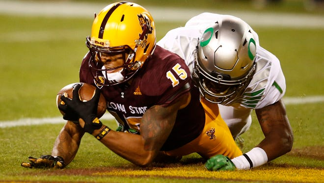 Arizona State Devin Lucien (15) makes a touchdown catch against Oregon's Arrion Springs (1) in the first half during a Pac-12 game on Oct. 29, 2015, in Tempe.