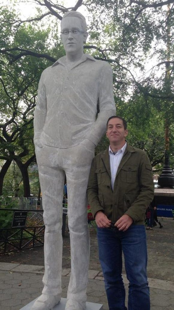 Journalist Glenn Greenwald, whose reporting last year in Britain's The Guardian disclosed secret surveillance programs thanks to leaks by Edward Snowden, took a photo with Jim Dessicino's statue in New York earlier this month.