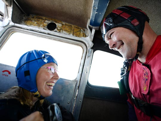 Instructor Chuck Bigler, right, grins at Marita Motter of Elizabethtown before doing a tandem jump. Motter was about to skydive for the second time in her life. The first was for her 30th birthday. This jump was to celebrate her 40th.