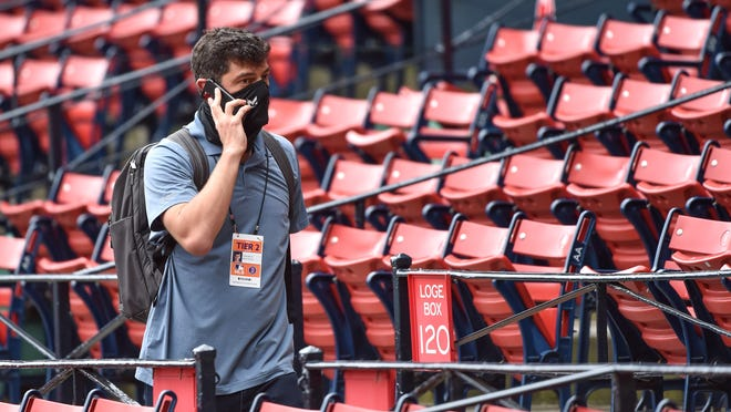Boston Red Sox chief baseball officer Chaim Bloom talks on the phone during summer workouts at Fenway Park on July 3, 2020.
