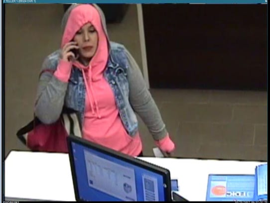 A surveillance photo shows a woman who robbed BMO Harris