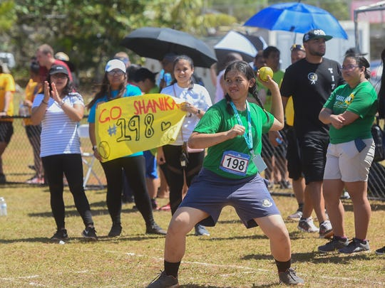Shanika Blas, 17, winds up on a softball throw during the 42nd annual Special Olympics Guam Track and Field competition at Okkodo High School in Dededo on March 17, 2018.