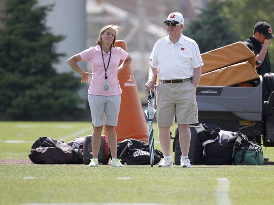 Katie Blackburn, Bengals executive vice president, left, talks with scouting consultant Bill Tobin, during rookie camp in 2015.