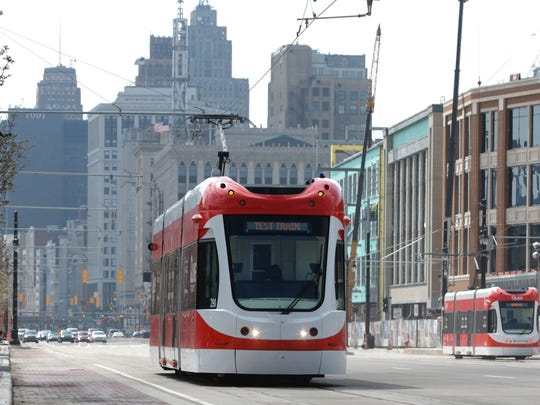 The QLINE heads north on Woodward passing by the Little Caesars Arena in Detroit on Tuesday, April 11, 2017.