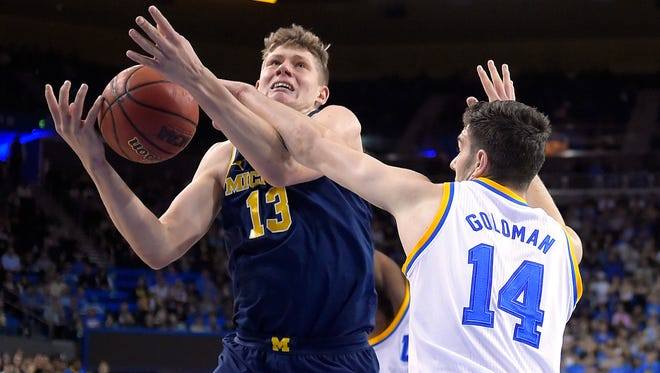 Moe Wagner is fouled by UCLA forward Gyorgy Goloman during the first half of U-M's 102-84 loss Saturday, Dec. 10, 2016 in Los Angeles.