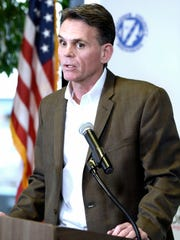 Macomb County Executive Mark Hackel announces that county clerk Karen Spranger has been removed from office by a judge.