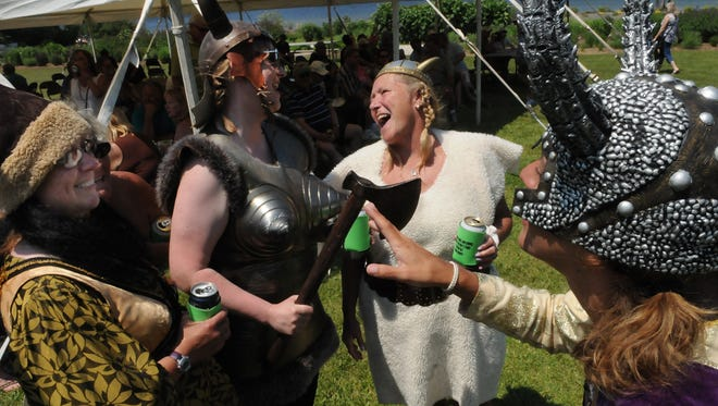 Dressed in their best Viking attire, Kathy Sitte, left, Jessica Manson, Wendy Smith and Debbie Tasnow share a laugh during Olde Ellison Bay Days on Saturday at Bayside Park in Ellison Bay.