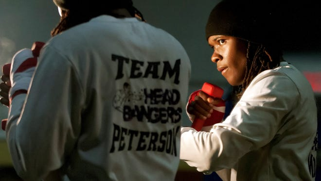 World champion boxer Tiara Brown worksout Wednesday at the Bald Eagle Recreation Center in Washington, DC. Brown is training for the upcoming Olympic trials.