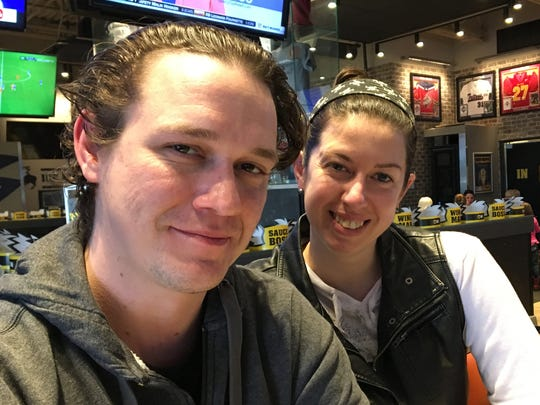Brandon Hansen, left, with Lyndsey Lue at Buffalo Wild Wings in Fort Dodge on Tuesday. Hansen is no fan of Donald Trump, and said he's been tweeting at the president to voice his displeasure.