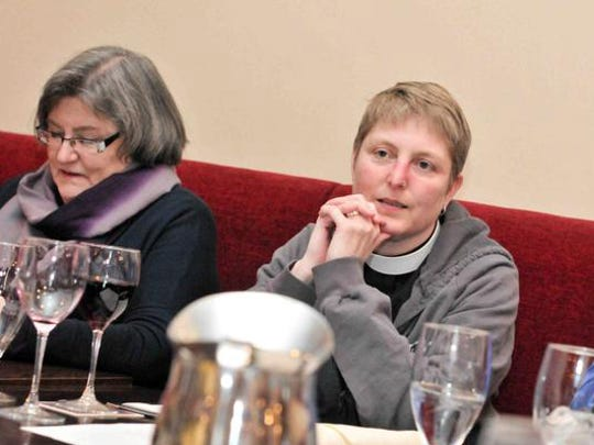 The Rev. Ginny Wilder listens as members of Trinity Episcopal's Parish meet for Beer and Bible Group at Ernest and Scott Taproom in Wilmington.