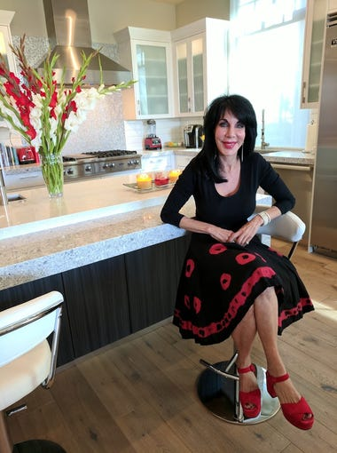 Dr. Loretta Malandro, a published author, speaker and executive consultant, sits in the kitchen of her Biltmore Estates home.