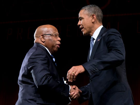 President Obama is greeted by Rep. John Lewis, D-Ga.,