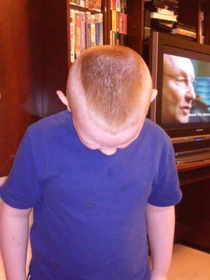 """The mother of a 7-year-old in Tennessee said this military-inspired haircut was deemed """"a distraction"""" by elementary school officials, who threatened to send the boy home if the style wasn't changed."""